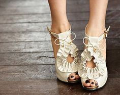 Pretty, ruffled shoes don't need to be paired with a soft pastel pedicure. Surprise everyone with a darker hue.