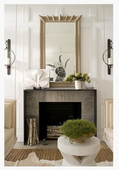 travertine tile surround with metal waterfall shoulder mantel - transitional and traditional paneling - dark metal - fireplace