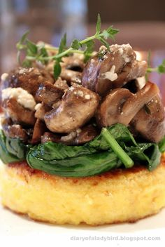 Polenta rounds with wilted spinach and roast mushrooms - Idea: cook the mushrooms in a skillet with garlic. Separately cook the spinach with vinegar and sugar mixture (like mom's cabbage salad). Top air fried polenta rounds with spinach & mushrooms. Veggie Recipes, Vegetarian Recipes, Cooking Recipes, Healthy Recipes, Vegan Polenta Recipes, Mushroom Recipes, Polenta Ideas, Vegetarian Brunch, Italian Recipes