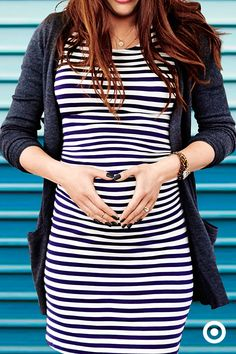 Flatter your figure in all the right places with this crisp, classic, on-trend, striped maternity dress from Liz Lange. The soft, stretchy fabric is designed to adjust to your changing figure for a pe