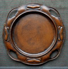 "Gustav Stickley serving tray catalog number 347, worn original patina. Measures 20"" in diameter."