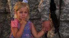 The story behind this picture...   Her dad was leaving on deployment. She was crying, and wouldn't let go of her dad's hand, even when he stood in line, saluting. Usually when soldiers fall in line getting ready for departure the families stand in front of them to say see you later. When command saw this little girl and how overwhelmed with emotion she was. No one had the heart to break them apart... God bless our military!