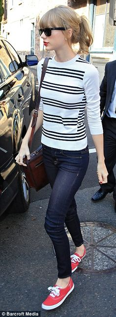 Cool and casual: The singer looked cute in a pair of denim jeans and a black and white striped sweater | Taylor Swift