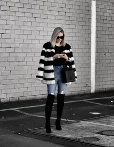 faux fur coat and over the knee boots.