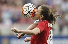 Houston, US Canada's Allysha Chapman is hit in the face as she goes up for a header alongside the US's' Carli Lloyd, during the CONCACAF Olympic women's soccer qualifying championship final at BBVA Compass Stadium. The U.S. won 2-0