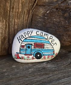 Offered here is an original art rock beach stone entitled Happy Camper. It is hand painted using acrylic paints and Uni Posca paint pens. It measures approximately 2 inches by 2.5 inches and comes to you signed, dated and protected by a double coat of clear matte acrylic sealer.