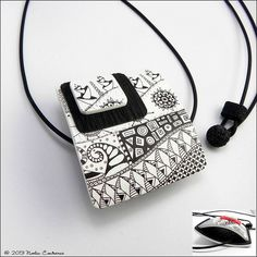 Noelia Col021 | Flickr - Photo Sharing! Zentangle reversible pendant with curvature.