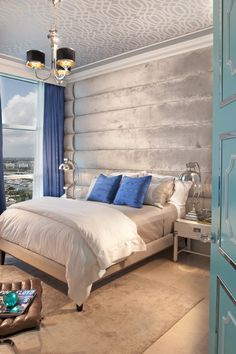 eclectic bedroom by DKOR Interiors Inc. Silver padded upholstered walls, beautiful ceiling, blue and gray/silver decor. Modern Bedroom Design, Contemporary Bedroom, Home Interior Design, Bedroom Designs, Eclectic Design, Modern Design, Bedroom Furniture, Bedroom Decor, Bedroom Wall