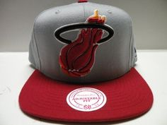 Mitchell and Ness NBA Miami Heat Big Logo Gray 2 Tone Retro Snapback Cap by Mitchell & Ness. $28.08. Product Weight: 8 OZ. Item availability can change quickly as item becomes popular.. Please refer to SKU: MNCMIHE-2TSGRCA when you contact us.. Brand Name: Mitchell & Ness. Guaranteed Authentic and Licensed by the league.. Authentic NBA Snapback Cap Mitchell and Ness Big Logo Gray Cap.