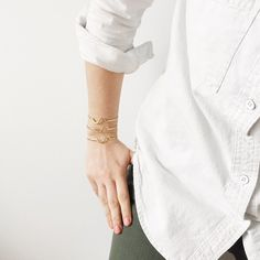 Layered Bracelets. Brass cuffs. Gold arm cuffs. Arm Party. || Stack three Moa cuffs for a chic and effortless look!