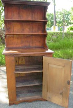 19th c. pine two part step back cupboard : Lot 21