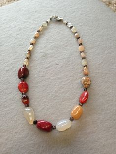 Natural Stones necklace. $36.00, via Etsy. (This is a lot of big stones, but I like the mix & match idea)