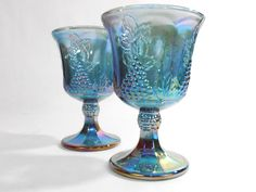 "$10.00 - Indiana Glass Blue Carnival Glass Goblet - Harvest (Grape & Leaf) pattern original catalog #0176 introduced in 1971. -Set of two. -Pretty iridescent blue carnival glass water glasses / goblets. -They stand approximately 5 1/4"" tall, and hold approximately 8 fl oz. ... Click on the image above for more info or to buy from WileWood. Thanks for your interest!"