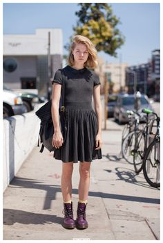 Chauntelle in Los Angeles. charcoal pleated mini dress and purple doc boots.