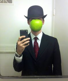"Becoming René Magritte's ""The Son of Man"" can be surprisingly simple if you have the suit and hat already. All you need is a photograph or high quality printout of a green apple to cut out and attach to the hat brim, assuming you don't mind not being able to see and all"