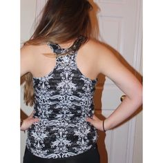 Black and white workout or everyday top Adorable black with white designs top. Great for working out in or for every day wear! Only worn maybe twice. Perfect shape! Offers accepted ❤️❤️ Tops Tank Tops