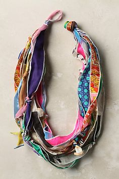 Making this TODAY! Scarf necklace by We Love Vera, makes for a fun DIY idea! Silk scarves are cut into strips, knotted and strung into a colorful scarf necklace hybrid.