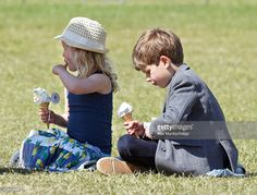 Savannah Phillips and James, Viscount Severn eat ice cream as they attend day 4 of the Royal Windsor Horse Show in Home Park on May 16, 2015 in Windsor, England.