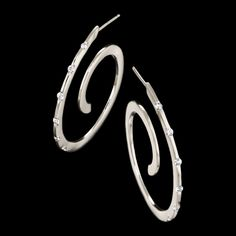 Spirale diamond earrings by Adam Neeley.  Spirale diamond earrings are timeless and chic. These unique and fashionable earrings feature diamonds set in 14kt yellow gold. Also available in rose and white gold.