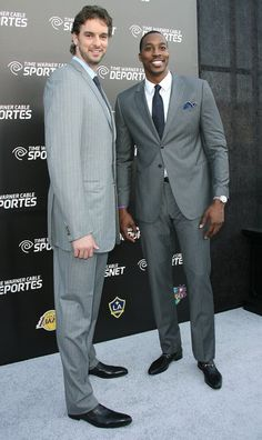 Sports and fashion DO go together: Los Angeles Lakers' centers, Pau Gasol and Dwight Howard looked dapper on the grey carpet at the launch of Time Warner Cable SportsNet. They both wore grey pinestripe suits but in different shades. Very nice, gentlemen!