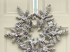 Snowy Pinecone Wreath | This winter white wreath is the perfect decoration to greet guests with a warm, holiday welcome.