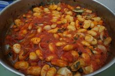 Baked beans in the oven with tomato sauce, onions and carrots as it usually cooked in Greece.