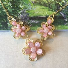 "Lace Cut-out Floral Trio Necklace in pink & gold Lace Cut-out Floral Trio Necklace in pink & gold. Approximately 15"" long with 3"" extender and lobster clasp. Lead and nickel free. NWT RETAIL The Honeybee Outlet Jewelry Necklaces"