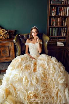 For the fairytale bride at heart, this sweet ivory ball gown from Royal Wed featuring hundreds of 3D flowers will make your dream come true! » Praise Wedding Community
