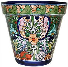 Talavera planters feature wonderfully intricate floral patterns that will look great with your plants, indoors or out!  The ceramic of these Talavera planters is hand-painted in Dolores Hidalgo, Mexico, and embodies all the classic charm of Mexican Talavera.  Available in several shapes and sizes, all Talavera planters also feature a convenient drain hole.  Let the bright colors and your plants breathe life back into your home decor!