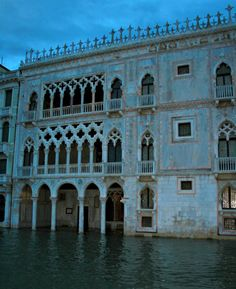 VENICE, ITALY- Beautiful Venetian architecture in the evening after rain fall with some flooding and rising water levels
