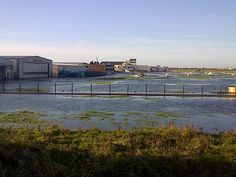 Flood defences on the western bank of the River Adur in Shoreham were over topped at Shoreham airport and a breach was created allowing flood water through. This flooded industrial units at the airport. See more pictures in our Flickr album www.flickr.com/photos/environment-agency/sets/72157638732...