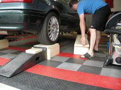 Wood car ramps with removable center section for access.