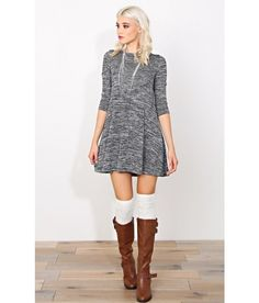 Grey marled trapeze dress with white over the knee socks and deep brown knee high boots