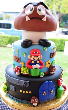I think just the mushrooom guy would make a doable cake...use a giant cup cake pan?