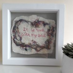 Put a bit of peace and positivity in your life with these embroidered words from an inspirational hymn. On a felted background with colourful sari silk and sparkly gold. Hang on a wall or put on a desk or shelf.