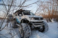 Being an official partner of the 2014 Winter Olympics in Sochi, Volkswagen is looking. Vw Toureg, Volkswagen Amarok, Vw Amarok, Volkswagen Group, Overland Truck, Expedition Truck, Pajero Sport, Jeep Cars, Wheels And Tires