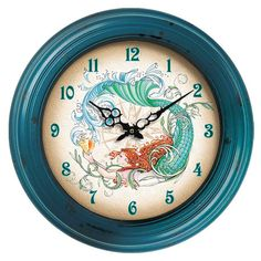 Wall clock with an ocean-themed design.    Product: Wall clockConstruction Material: MetalColor: Peaco...