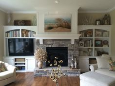 I like the set up of the fire place with the built in cabinets and the positioning of the couches