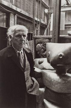 Max Ernst, in front of his sculptures, Paris, 1968