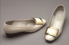 Roger Vivier - France 1965  White patent leather shoes: low heel; rounded toe; metal flat buckle