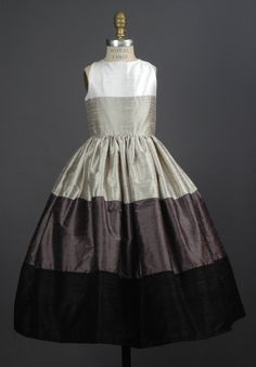 High neck ballgown with color block color tiers.  Self sash with back bow tie.  Optional sleeves and change of neckline.  100+ colors.  Made in USA