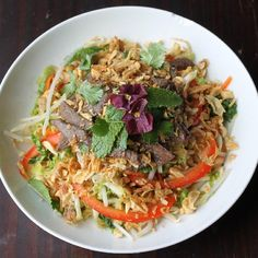 Delicious and addictive Thai inspired salad, topped with lean top round steak, peanuts, and fried shallots.