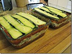 "Zucchini Lasagna: •1 large onion, chopped •2 cloves garlic, minced •1 (24oz) jar tomato sauce •1 lb ground turkey •1 egg •2 cups low fat cottage cheese •1 tsp whole wheat flour •1/2 cup skim mozzarella cheese •2 1/2 cups (2 medium) zucchini sliced 1/4"" thick •salt  pepper to taste"