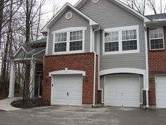 Gray siding and brick | Home Exteriors (Hail Damange Home Makeover