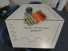 Scissor skill provocation on the mark making table…