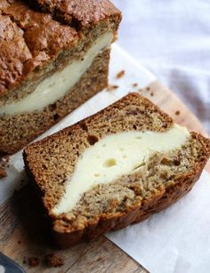 Cheesecake Stuffed Banana Bread...it's a classic treat turned on it's head. The thick ribbon of cheesecake is creamy, rich and the perfect pairing with the buttery banana bread!