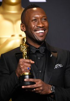 """Mahershala Ali Wins 2017 Oscar for Actor…  Mahershala Ali, Oscar 2017 winner for Actor in a Supporting Role for """"Fences"""", poses in the press room during the 89th Academy Awards."""