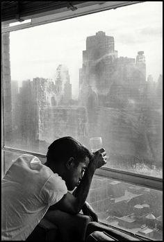 Sammy Davis Jr. looks through Manhattan window, New York City, 1939