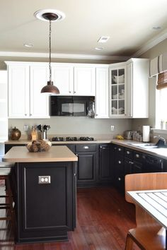 Painted kitchen cabinets white upper black lower ascp for Kitchen cabinets 999