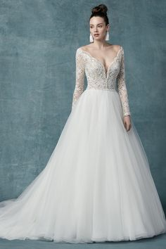 A-line wedding dress idea with long lace sleeves and v-neckline - Style Mallory Dawn by Maggie Sottero - Learn more about this Maggie Sottero gown on WeddingWire! sottero wedding dresses a line Wedding Dress out of Maggie Sottero - Mallory Dawn Lace Wedding Dress, Maggie Sottero Wedding Dresses, Long Wedding Dresses, Long Sleeve Wedding, Bridal Dresses, Wedding Gowns, Winter Wedding Dress Ballgown, Tulle Wedding, Prom Dresses